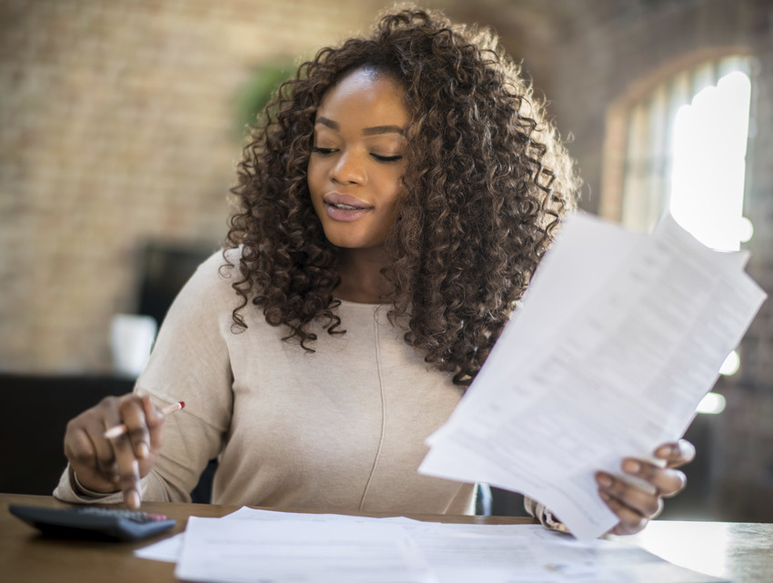 woman considering real estate options