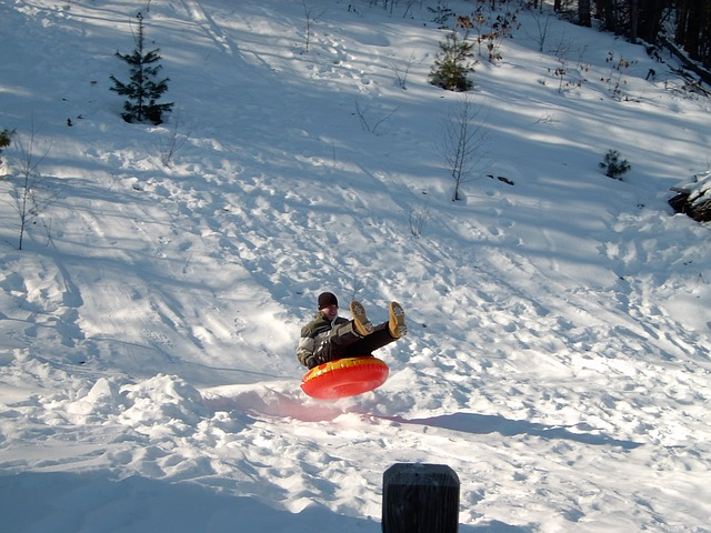 sledding in an innertube