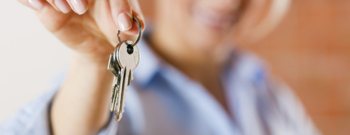 holding keys to a house