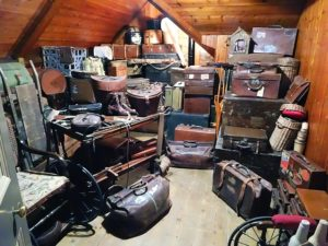 attic filled with suitcases and boxes