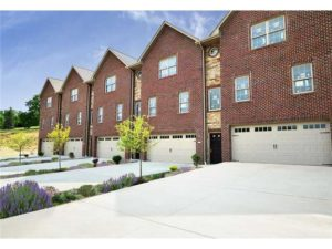 Townhomes with brick exteriors and garages.