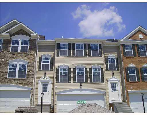 3-story townhomes in a Colonial architectural style.